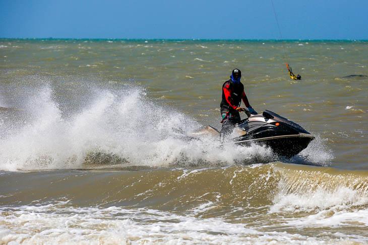 Jet ski rescue kitesurfer in water